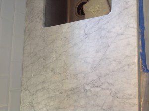buffed white carrera marble counter